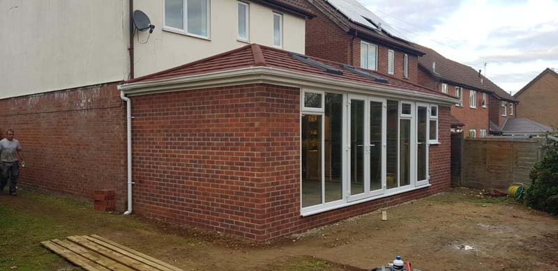 solid roof extension with metro tiles